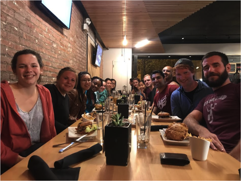 Students from Booth, Law, Physical Sciences, and Molecular Engineering enjoying burgers after an afternoon of rock climbing.
