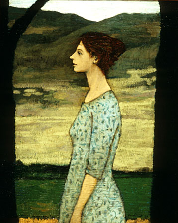 A woman in the space between trees