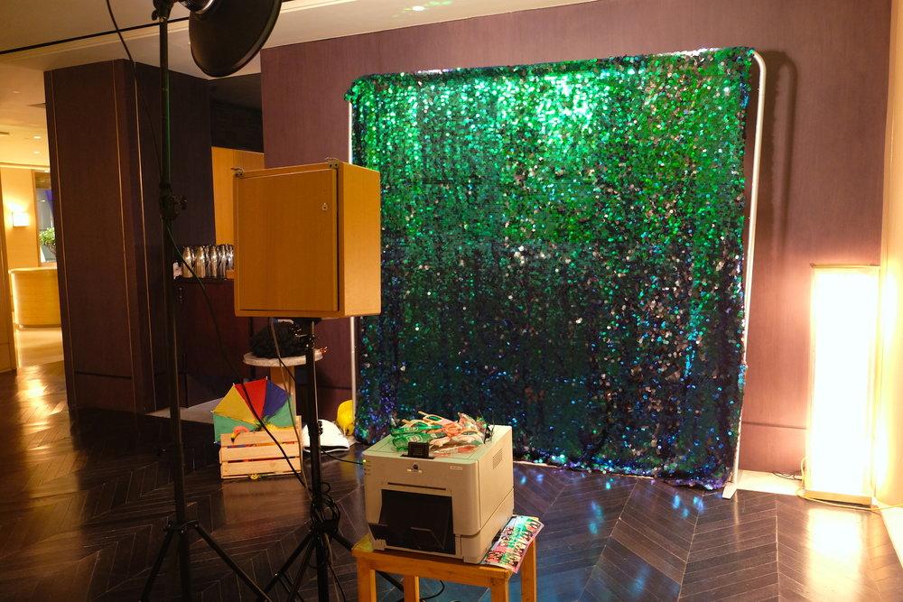green sequin backdrop.JPG