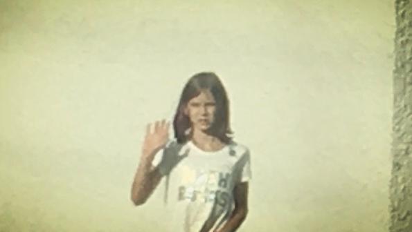 Maya waving goodbye.