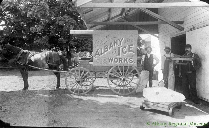 Albany Ice Works at the west end of Third, near Byrant's Park Bridge, c. 1906. This horse-drawn ice truck delivered ice to customer's doors daily in early Albany. A section of the ice house building still remains.