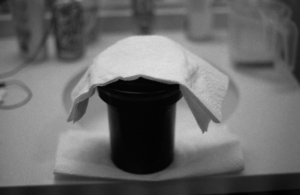 Developing film at home with a Patterson tank, shot with a Minolta XGM on HP5+ @ 1600