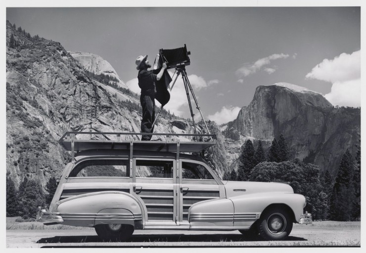 Ansel Adams photographing Yosemite from the top of his car. Cedric Wright, Ansel Adams: Photographing in Yosemite, 1942, gelatin-silver print, Collection Center for Creative Photography, The University of Arizona, © 1942 Cedric Wright