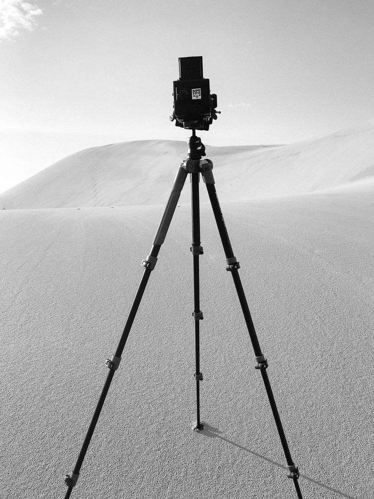 "Be careful ""zooming in"" with prime lenses on sand dunes. You don't want to leave your footprints everywhere!"