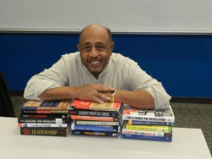 Brandon-Hamilton-Leaning-on-Books.jpg