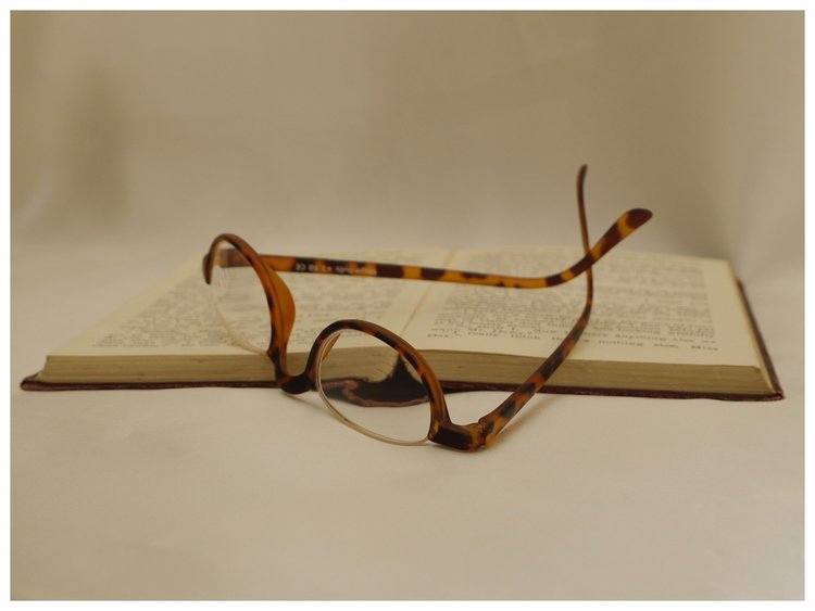 plastic framed half-eye reading glasses in tortoiseshell effect.