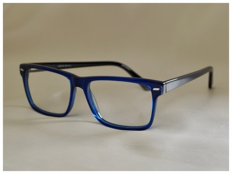 a pair of spectacle frames with glass lenses.