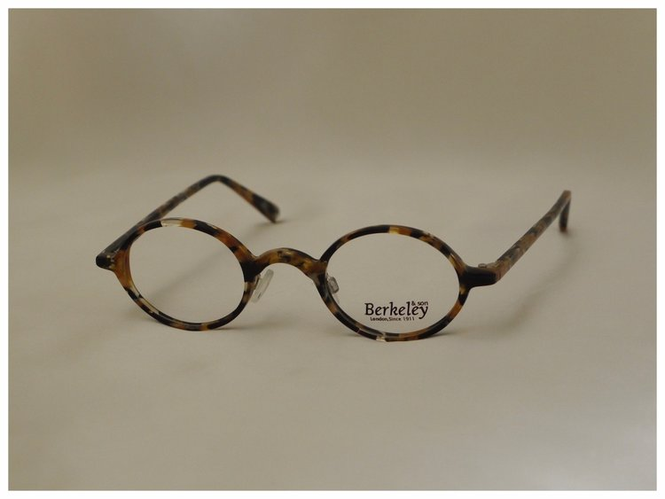 small pair of oval shaped, plastic reading glasses