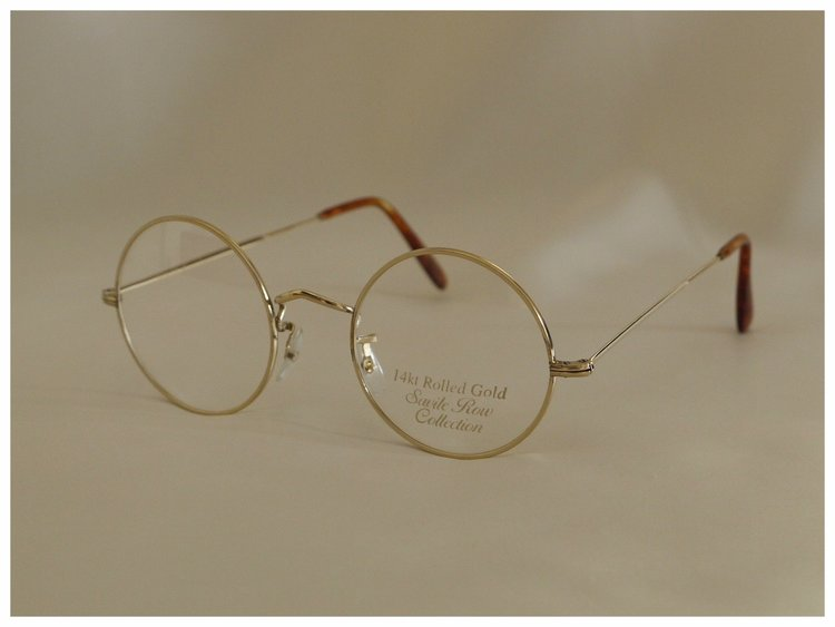 large round-eye reading glasses in a handmade, gold spectacle frame