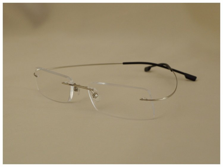 pair of rimless reading glasses.