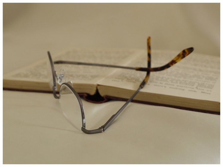 half-rim reading glasses in a thin, metal spectacle frame