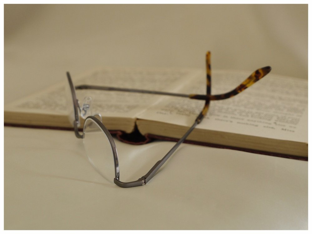 Back in stock! - These 'peer over the top' half-rim glasses in a gun-metal coloured frame are once again available.