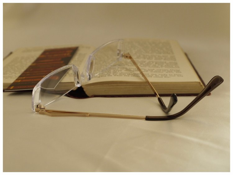 pair of reading glasses with pocket clip