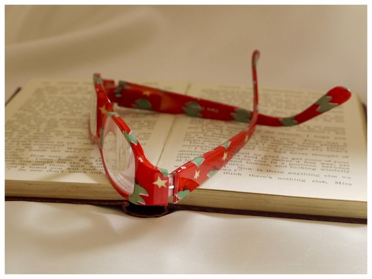 pair of reading glasses with Christmas tree pattern