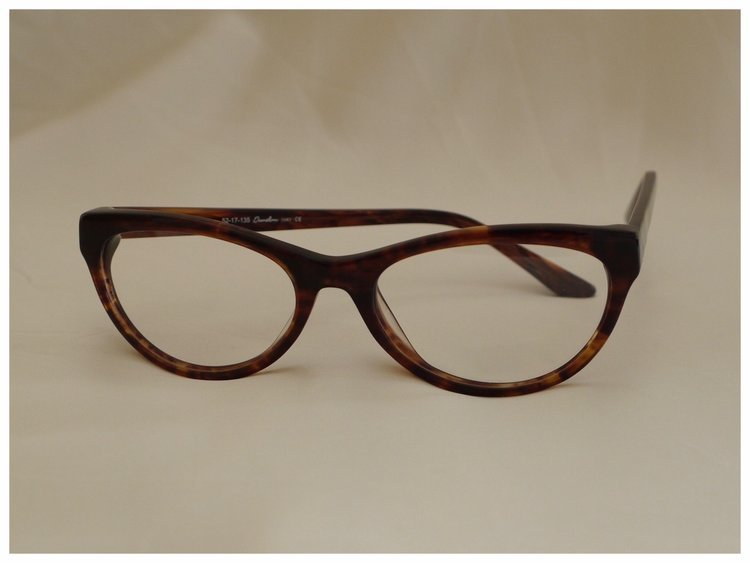 A pair of plastic reading glasses in a tortoiseshell design.
