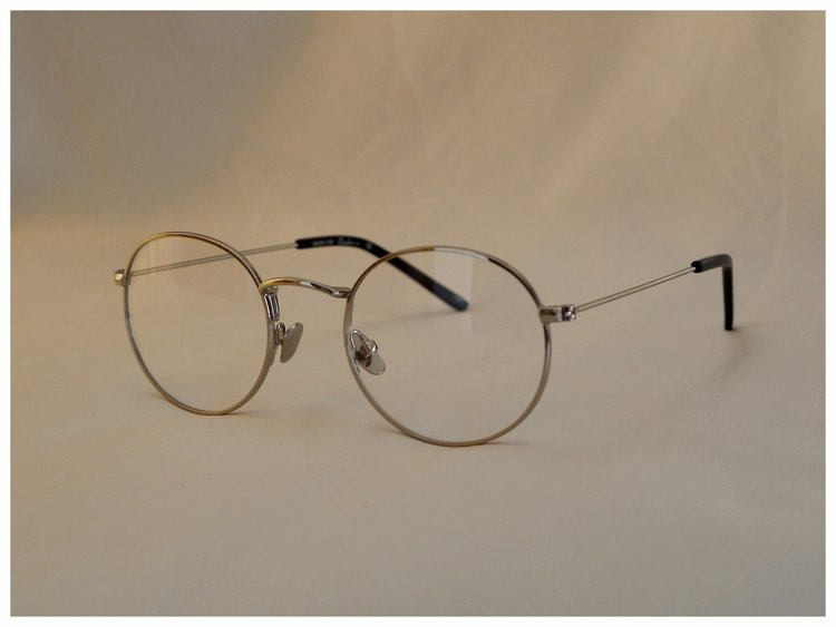pair of silver coloured reading glasses in a classic design