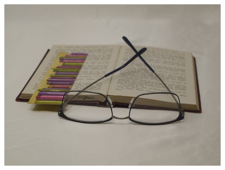 reading glasses on open book.