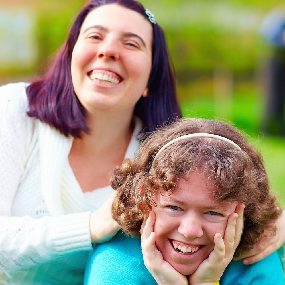 53610885 - portrait of happy women with disability on spring lawn