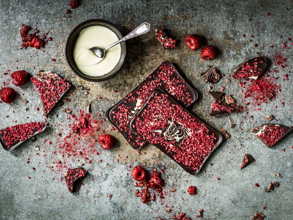 Raspberry Crumble - That Special Day in the Year. Christmas, Valentine's Day, birthdays, each an opportunity to mark the year by creating unforgettable moments of joy with someone you love. This year, make them swoon with the splendid combination of vibrant raspberry and white and dark chocolates with Rhoda Cocoa's Raspberry Crumble chocolate bar. A luxurious moment worth sharing year after year.
