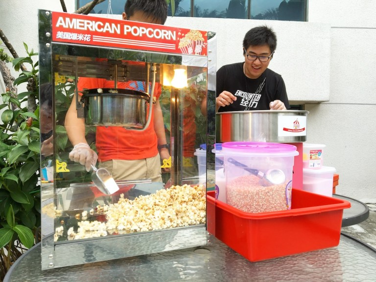 POPCORN LIVE STATION - Popcorn Machine Rental is one of the most popular snack rental that every event needs. Having popcorns at your event never fails to get your guest excited as they have something to chew on while roving around your event.