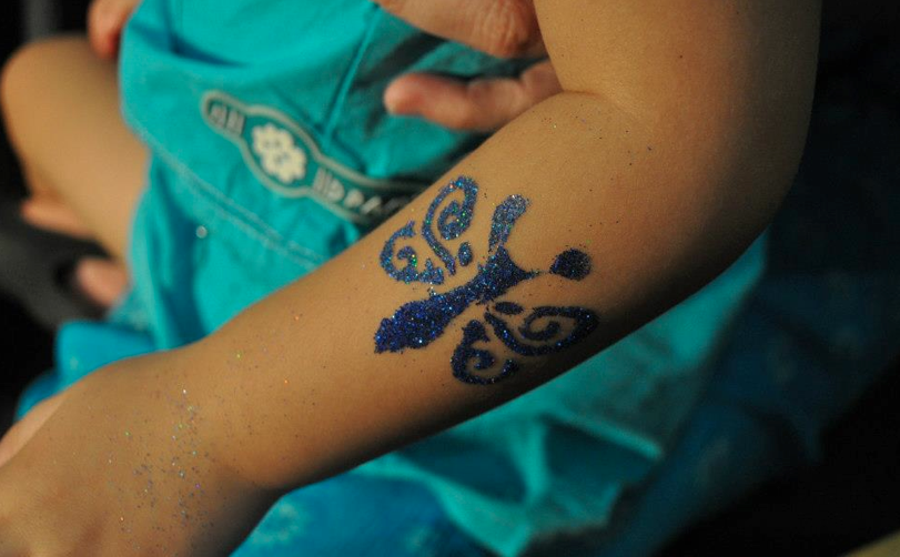 GLITTER TATTOO - Unlike Airbrush Tattoo and face painting, Glitter tattoo is the popular event services among children as they enjoy the luxury of staring at the art shinny on their skin. With many designs to choose from, glitter tattoo is also suitable for both genders and all ages!