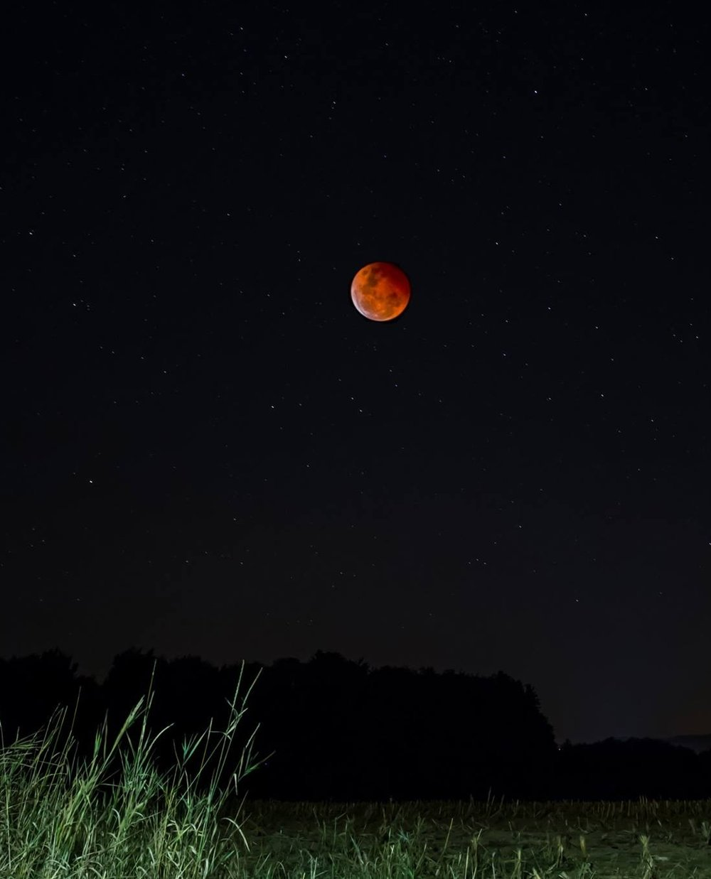 A shot of the 2015 lunar eclipse, as seen from southern Germany! This was shot at 70mm and cropped!