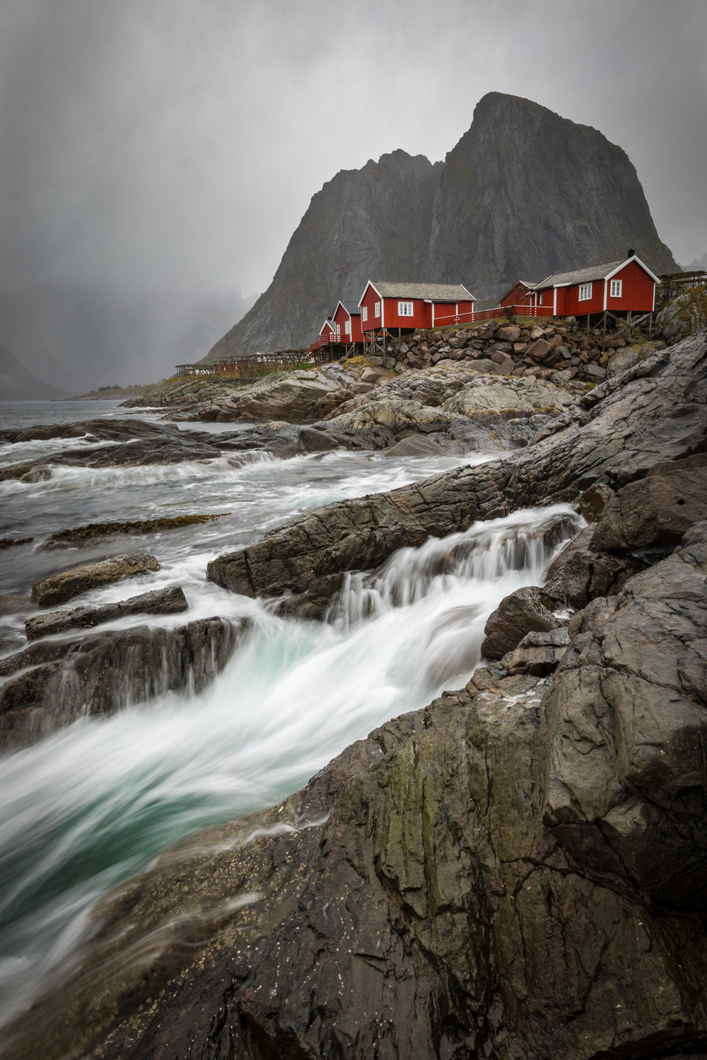 This image is taken on one of the worst days I've seen on the Lofoten this far. It took me over an hour and 6 images to get one I was happy about. Raindrops and the right timing, made this really hard. I had packed my camera a couple of times as the rain worsened. I was soaking wet, even my waterproofs seemed to be at a point of giving up. Rain was literally dripping from my camera, but I am stoked about the final result! Tamron SP 15-30 | 19 mm | f/18 | 1/3 sec | ISO 100.