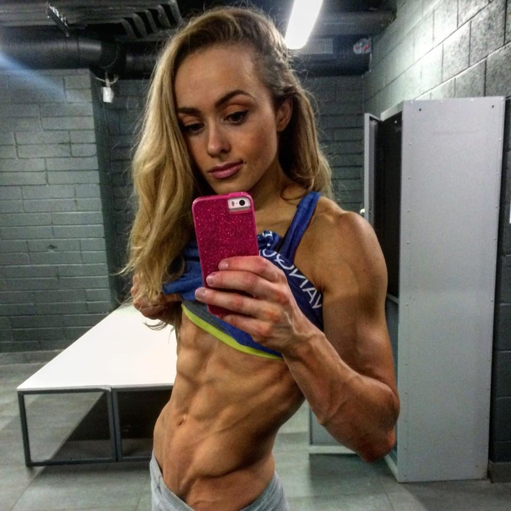 Jessica Gretsky  - Irish athlete known for strong abdominals. Photo illuminates her obliques.