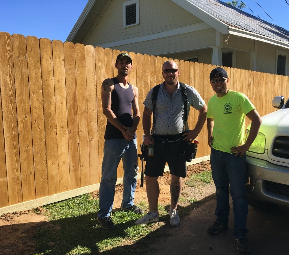 Michael Perez, Chris Yaw and Preston Cooley built the Gateway Mortgage Group fence.