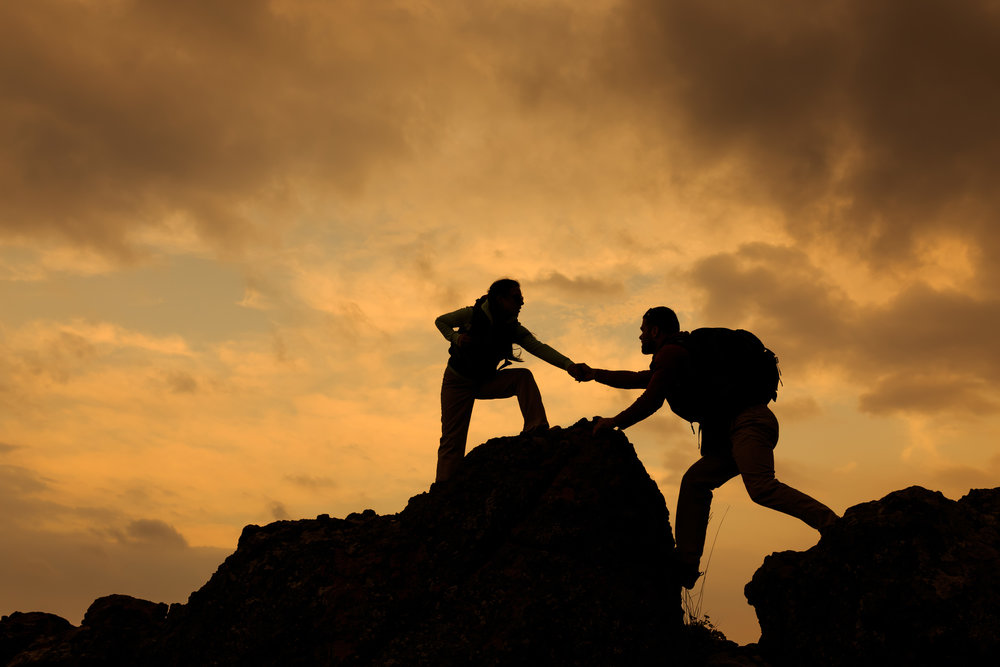 Man-and-woman-help-silhouette-in-mountains-489516138_5612x3741 (1).jpeg