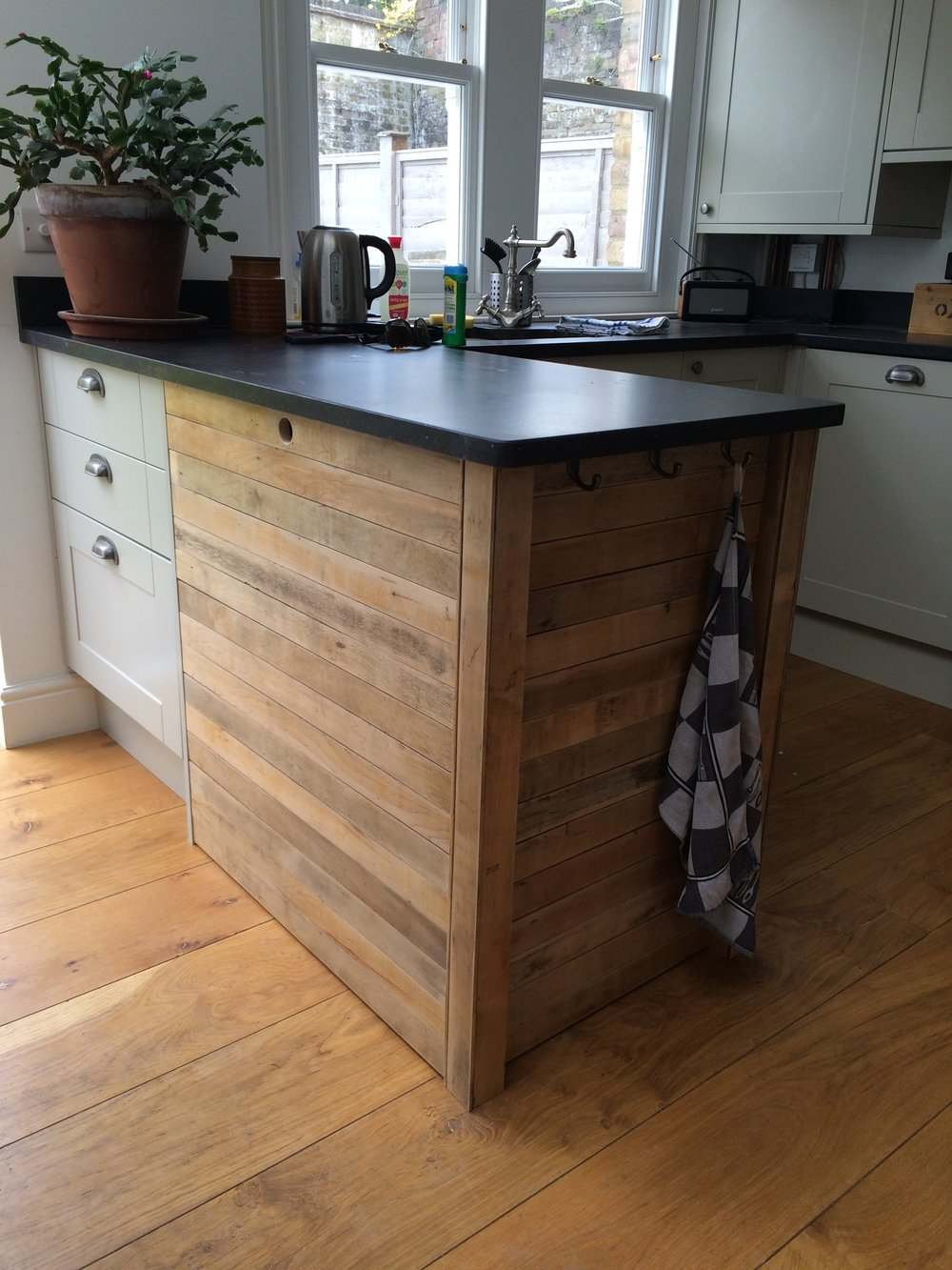 kitchen island in reclaimed maple floorboards