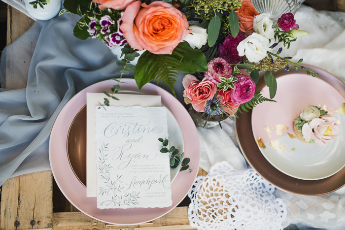 i want to take a moment to appreciate this gorgeous set up with some vendor love - see that invitation? Calligraphist kei haniya goodmancreates such an elegant, artful touch to traditional invitations. doesn't that flower cupcake look delicious & beautiful? bet you wouldn't guess it's vegan & gluten free.ungrained bakeryhas solved world peace, giving us healthy sweets!! this design wouldn't be complete without the vibrant pop of color from the budding florist