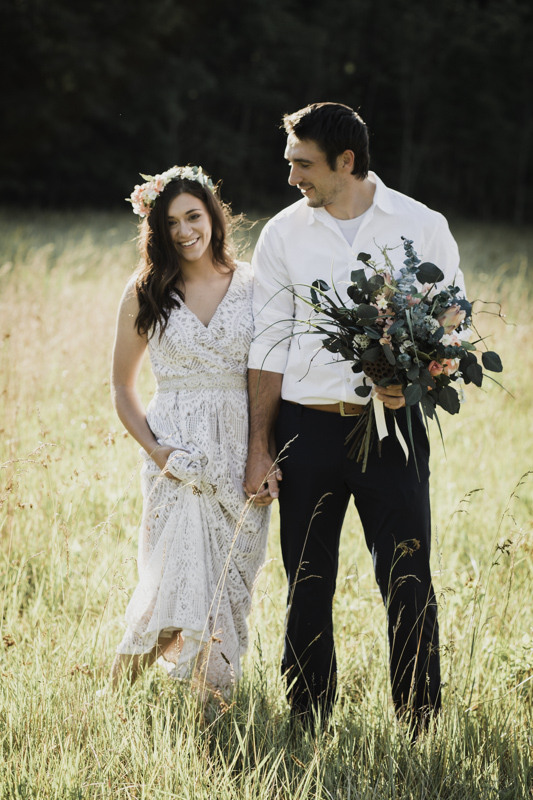 Only the best grooms carry their bride's bouquet when walking through tall grass;)
