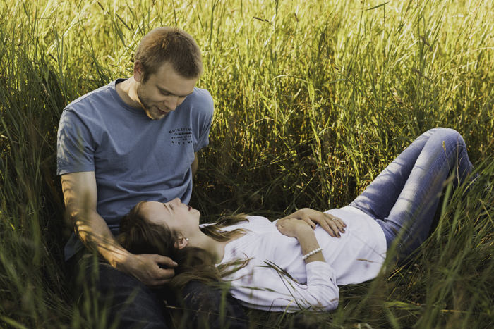 every country love song i grew up just flooded me at this very moment. how romantic to cuddle up in a huge field? zack just began pulling grass and drawing on her chest. it was the cutest moment.
