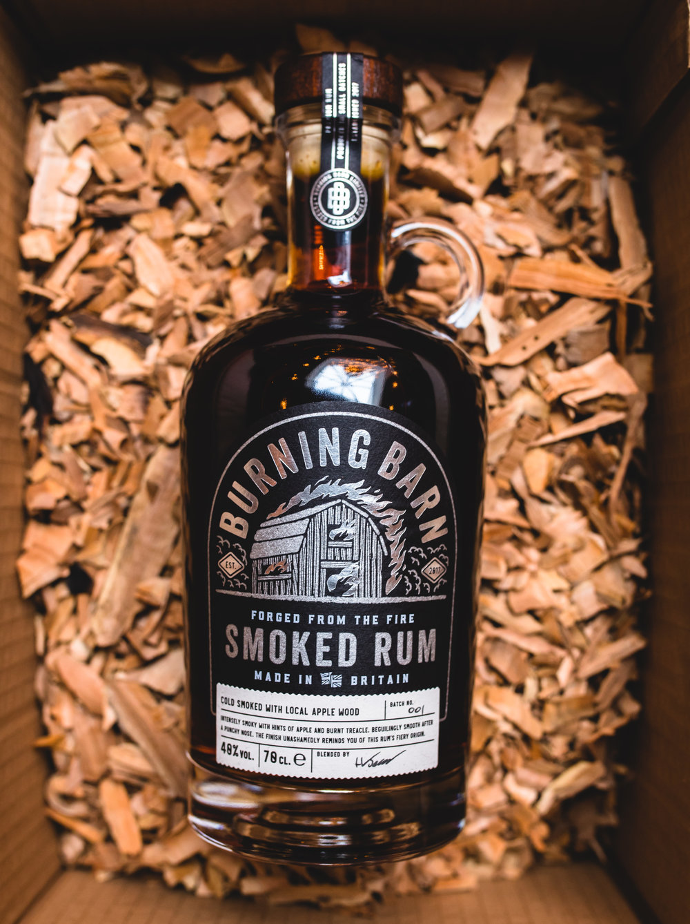 SMOKED RUMThe UK's first Smoked RumThe finest dark rumcold smoked with local apple wood for a uniquely smoky taste -