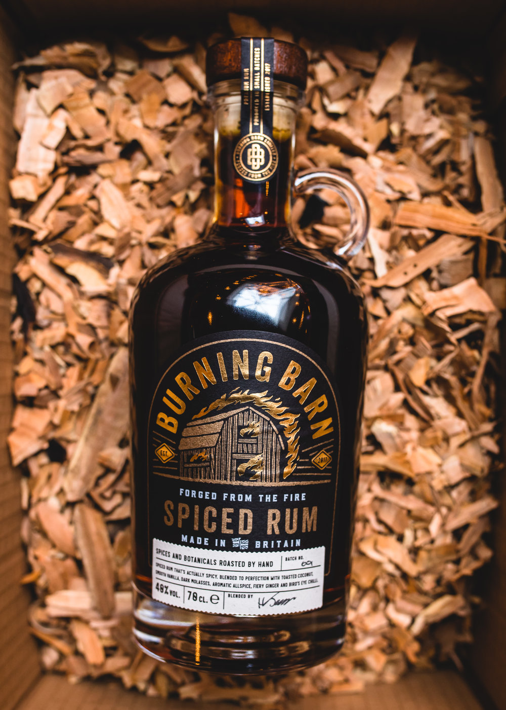 SPICED RUMSpiced Rum for Grown UpsDark rum infused with Vanilla, Allspice, Chilli, Coconut and Ginger hand roasted in copper vessels on siteOnly the finest whole spices, no artificial additives or flavourings -