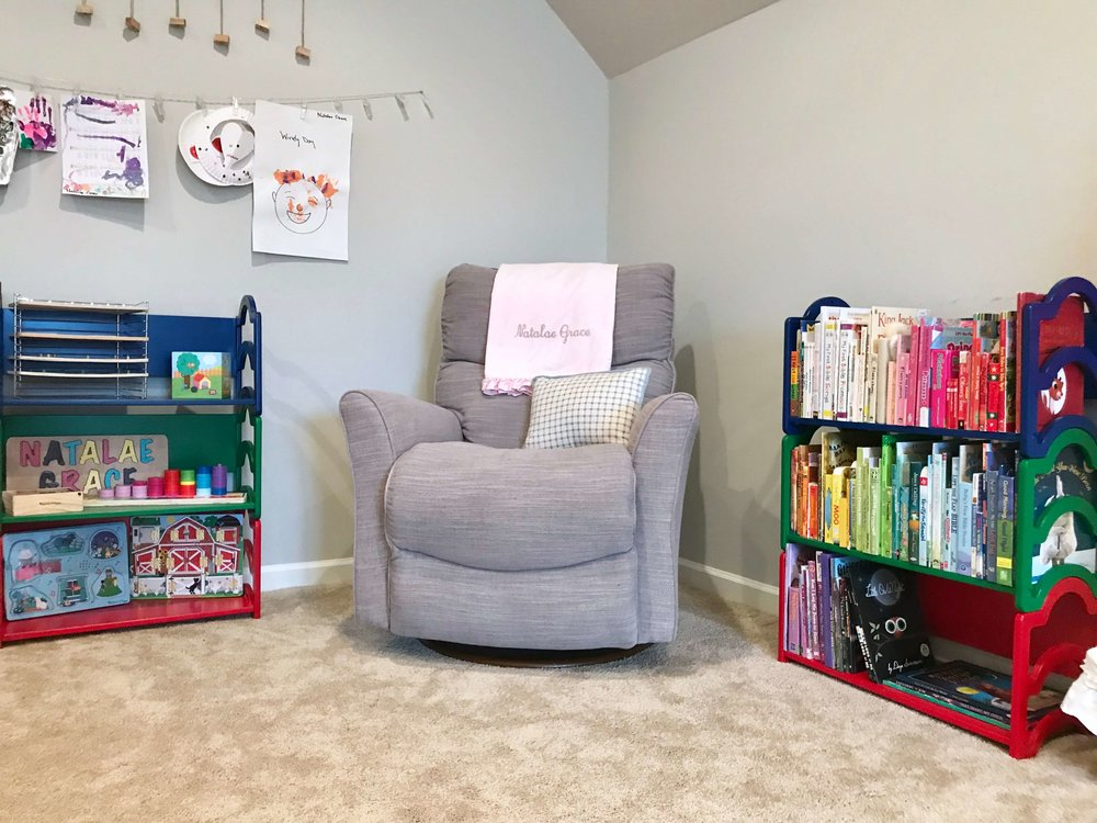 This organized playroom shows a great way to display books and puzzles.
