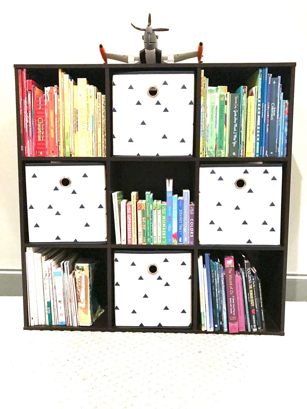Styled and color coded kids' bookshelf.