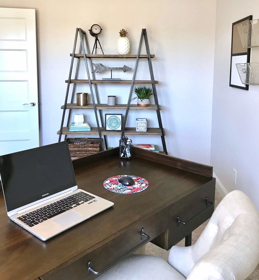 A clear workspace in this home office will help increase productivity.