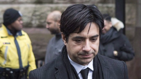 Ghomeshi pictured outside the courthouse earlier today. Photo via CBC.