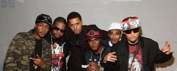 J. Cole alongside Bone Thugs-N-Harmony at an event for Beats Music.