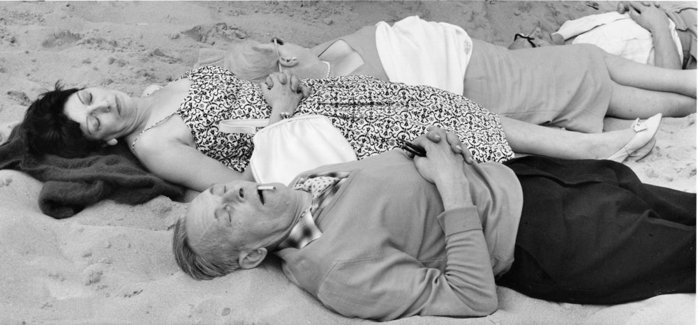 2 couples asleep on beach, 15-98-2 (1961).jpg