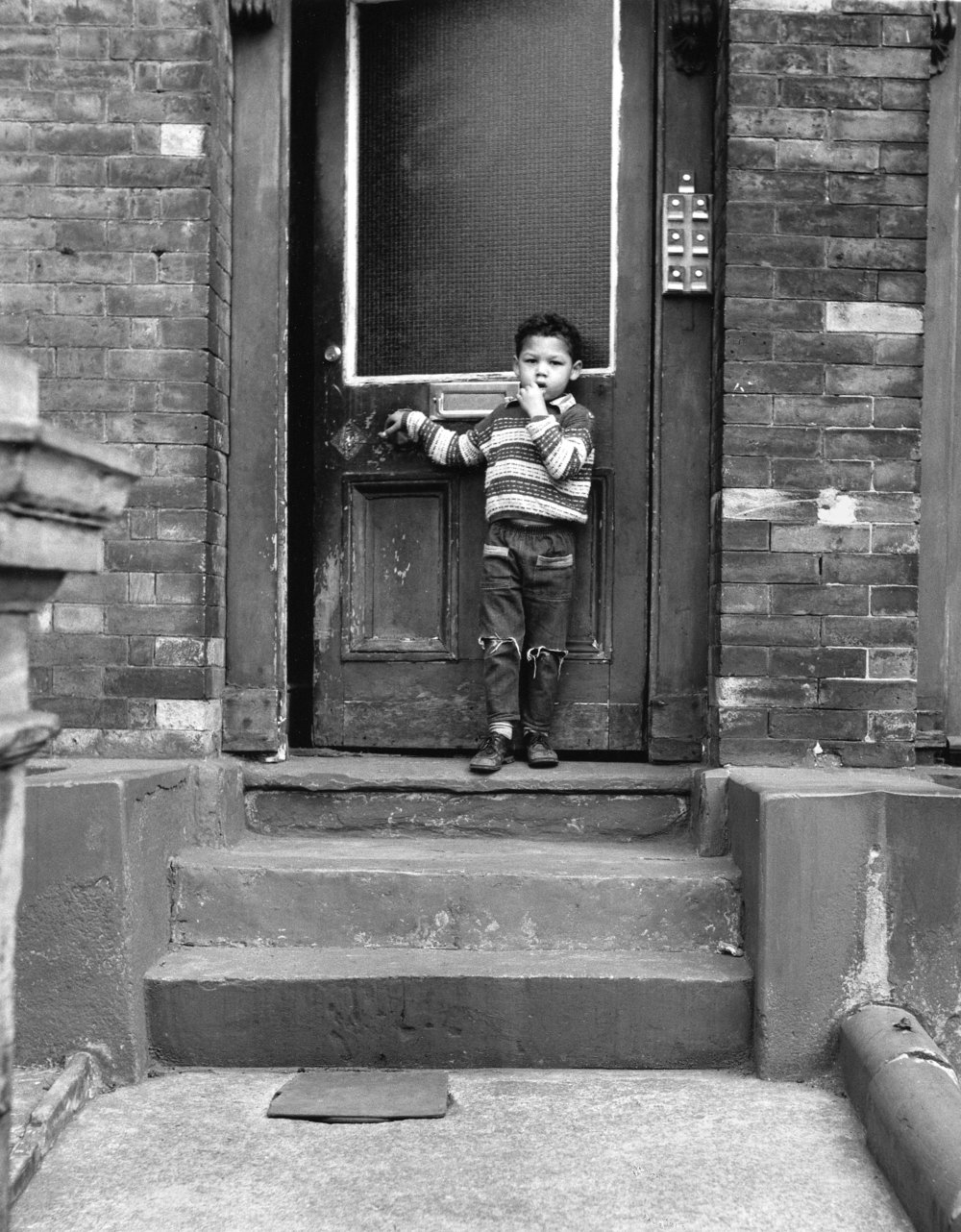 Cheetham, Mcr., Boy Outside House, 18-67-3 (1966).jpg