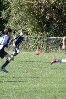 Drew playing soccer