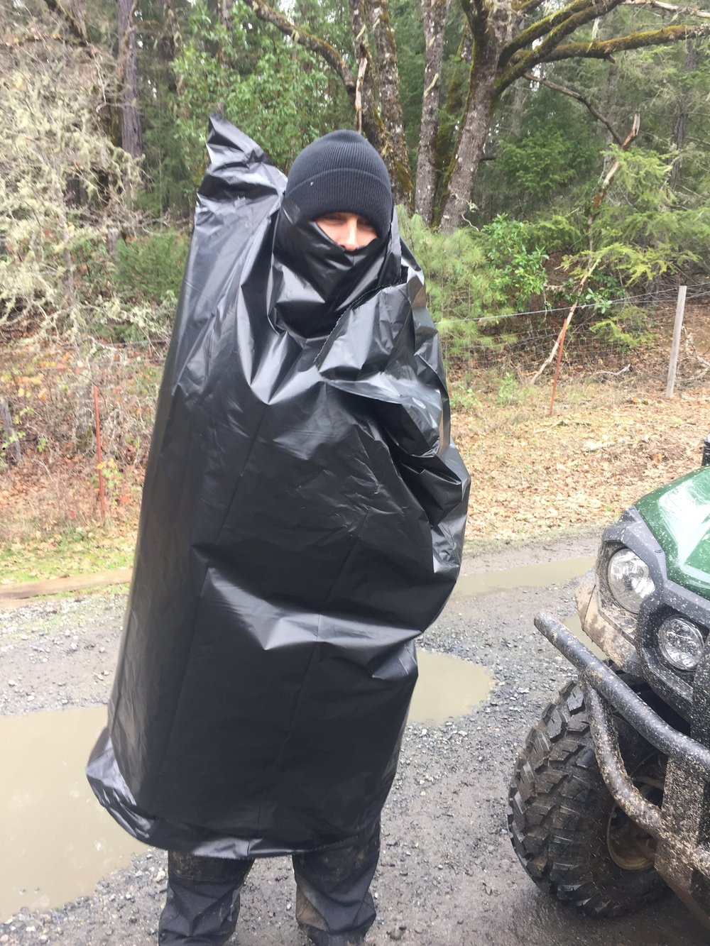 So anyway this homeless guy walked on the property dressed in a garbage bag-- well you can imagine--I wondered what institution he escaped from!  It is, of course, Mr Ryan Cooper, Farmer Extraordinaire, The Culvert Rat, The Bag Guy, Vineyard Pest, et al!
