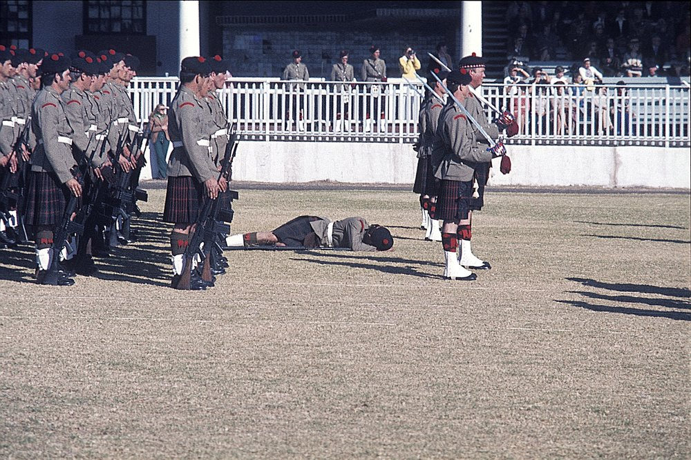 Pipe Band at a Highland Gathering-- poor guy keeled right over in the heat.
