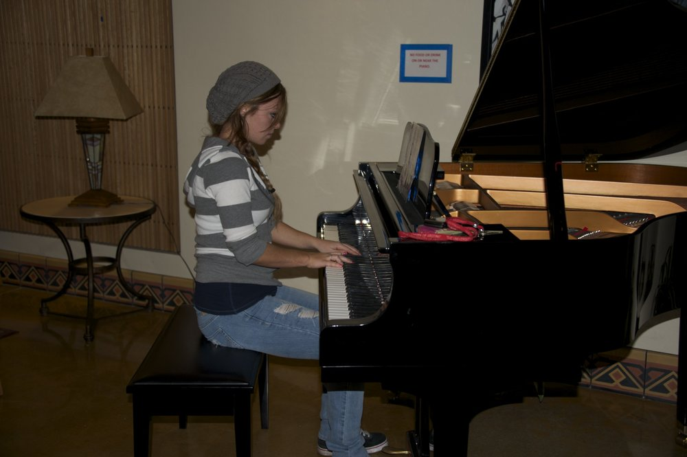 I saw the Baby Grand and asked her to play. She is a very accomplished pianist. Played and studied for years.