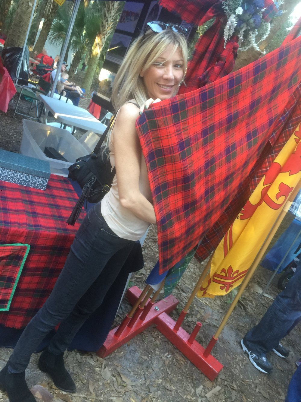 Vanessa at the Highland Gathering in Orlando- checking out The Robertson plaid.