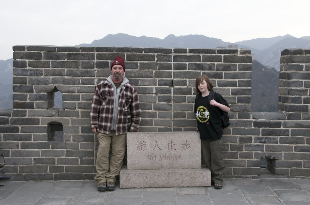 Drew and I at the Great Wall    This was as far as you could walk on the wall--- Mongolia on Drew's side -- China on my side.