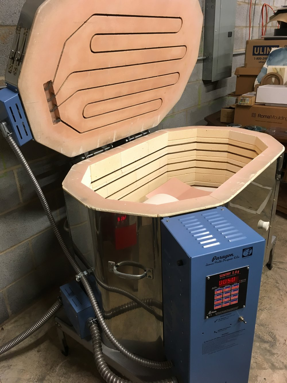 This is my biggest electric kiln. (Similar to kilns used in pottery, but shelves and heat/firing schedules are different.) I LITERALLY use the heat and gravity to mix my colors:)